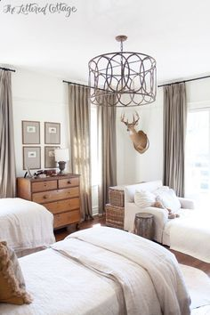 Boys Bedroom | Old House | Chandelier | Light Fixture | Antique Pine Dresser | White and Neutral the look I want in our master.... love the pictures matted in that color, white walls, curtains, natural wood and baskets....