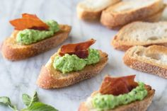 This is an ideal spring-time appetizer. A sweet pea and ricotta spread pairs perfectly with crispy, salty prosciutto on these mini toasts.
