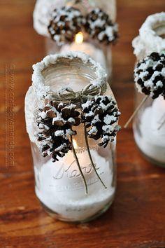 winter candle decor: spray snow, twine and pinecones