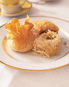 Rolled Baklava with Golden Raisins In this variation on the classic dessert, the nut-filled pastry is wrapped in a threadlike dough called kadaifi. Turkish Recipes, Greek Recipes, Lebanese Recipes, French Recipes, Filipino Recipes, Ethnic Recipes, Best Baklava Recipe, Greek Desserts, Greek Sweets
