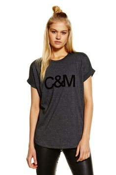 Camilla And Marc Black Logo Roll Sleeve Tee find it and other fashion  trends. Online shopping for Camilla And Marc clothing. Black logo roll  sleeve tee by.