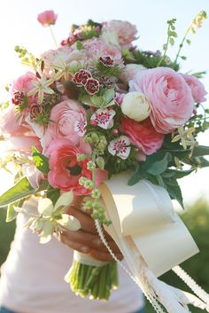 Pink Sweet William and Ranunculus. weddingflowersbycyndi.com will be glad to create this look for you.
