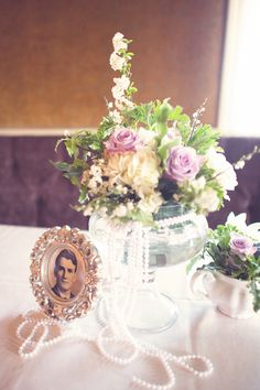 wedding centerpieces, purple wedding details, antique photos, family photos, The Semple Mansion in Minneapolis, paper anter photography