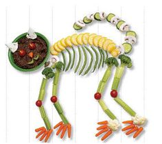 Feelin' up for a bit of a challenge? Creepy Skeleton Cat is sure to impress. Use carrots, cucumber, mushrooms, tomatoes, lemons, cauliflower & broccoli to imitate the shape. A bowl of dip or low-fat chocolate pudding makes a great head!