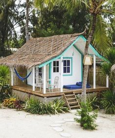 Take your inspiration from this adorable tropical style beach shed.... and create your own little tropical beach escape in your own backyard. For more she shed ideas, click over to Completely Coastal. Tiny Beach House, Tropical Beach Houses, Tiny House Cabin, Tiny House Design, Tropical Beaches, Surf Shack, Beach Shack, Cabins And Cottages, Beach Cottages