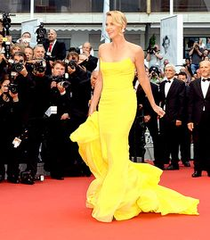 Charlize Theron wowed on the red carpet of the Mad Max: Fury Road premiere at the 2015 Cannes Film Festival on May 14, wearing a Christian Dior Couture canary yellow strapless gown with a long elaborate train.