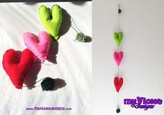 Móvil, colgante corazones de fieltro de colores con pompones, My Violet. :D myvioletdesigns.com
