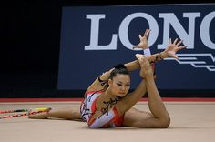 Kazakhstani rhythmic gymnast Aliya Yussupova performing hoop routine (2008).