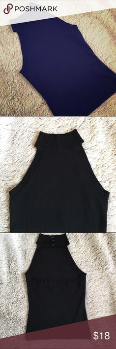 High Neck Open Back Top-Like New Black firm fitting mock turtleneck tank with an open back. Silky sweater like material. Has 3 tiny buttons at the back of the turtleneck for closure. Fabric content is silk, viscose, spandex. Don't think it was ever worn. Classically sexy piece❤️ Forever 21 Tops