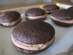 In these whoopie pies, two moist chocolate cakes are filled with a lighter than air chocolate cooked cream.