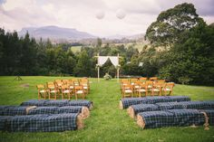 Definitely bales of hay as the seating for the ceremony. with white/blue throws