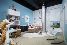In love with this room - it would make an ADORABLE play room for the kiddos.  The back is wallpaper that is available to purchase at Landofnod.com