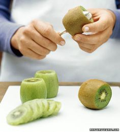 "How to: Peel a kiwi | Fruit with a name like ""kiwi"" shouldn't leave you aggravated when you try to peel it. To quickly skin it, Martha Stewart recommends trimming both ends of the fruit and easing a tablespoon between the flesh and the peel. Turn the kiwi, pressing the back of the spoon against the peel as you go, and the whole fruit should slide right out."