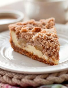 Snickerdoodle Cream Cheese Apple Pie is made with a snickerdoodle cookie crust, a layer of cream cheese, chopped apple pie filling and a snickerdoodle crumb topping.