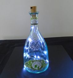 Use a beautiful clear glass wine bottle with a string of pure white led fairy lights.