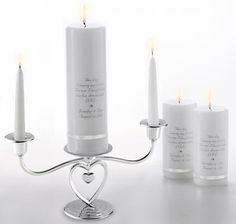 """$67.99 FREE PERSONALIZATION Wedding gifts, wedding candle. Our heirloom quality deluxe wedding unity candle with silver heart stand set is hand printed and hand polished. Includes 3""""x 9"""" banded unity candle, holder, two 6"""" dripless taper candles, and two 3""""x 6"""" gift candles. Pillar candles banded with ribbon in your choice of four colors. Choose white or ivory candles, candle image, ink color and ribbon color. Personalize with bride and groom's first names and wedding date."""
