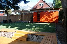 like the shed and the gabion wall seating