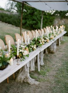 Rustico romance table decor featuring all the candles Can we just talk about those tree stump accents on this table? I cant be the only one that wants this for their house / planning photo: florals: silk runner: paper: chairs: Grecian Wedding, Rustic Wedding, Dream Wedding, Wedding Dreams, Boho Wedding, Wedding Cake, Centerpiece Decorations, Wedding Table Decorations, Wedding Reception Flowers
