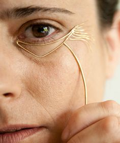 Israel's Bezalel Academy art student Noa Zilberman, who's crafted a one-off series of jewelry that emphasizes and accentuates the fines lines and wrinkles on her face.
