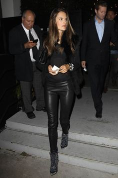 black leather leggings, black fur coat and studded boots. (pictured: Alessandra Ambrosio) #streetstyle #fashion #modeloffduty