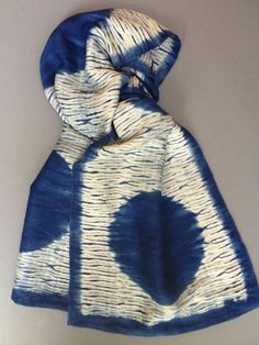 Shibori Circle by Catherine Ellis; after the threads are pulled tight and the dyeing is complete.  She is weaving the cloth while at the same time creating the shibori patterning threads for the dye bath