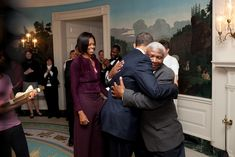 President Barack Obama hugs retiring White House butler James Ramsey, as First Lady Michelle Obama looks on, in the Diplomatic Reception Room of the White House, Jan. 25, 2010. (Official White House Photo by Pete Souza) Most iconic Pete Souza photos...