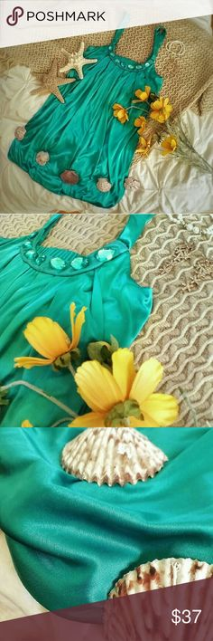 Turquoise Bubble Dress Beautiful silky material. Good condition. Has a medium sized cutout on the back. The jewels have a habit of turning around so the wrong side is showing..but that's fixable with a needle and thread (I can fix it upon request). Additional keywords: party evening wedding semi-formal semiformal semi formal satin teal blue-green pretty girly cute fun playful gems jeweled As U Wish Dresses Backless