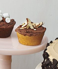 Yellow Cupcakes With Chocolate Sour Cream Frosting and Toasted Almonds - Yes, I am aware of my cupcake obsession. Shut it.
