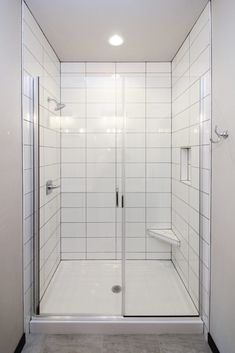 White tile shower with gray grout and glass shower door. White Tile Shower, White Tiles, Glass Shower Doors, Shower Doors, Custom Door, Bathtub, Doors
