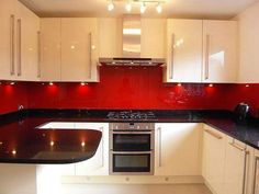 Simple Medium-Sized Red And Cream Minimalist Kitchen With Artificial Lighting #Kitchendesign #Kitchendesignideas #Kitchens