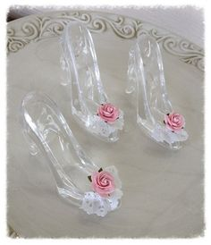 Darling small glass slippers can decorate a wedding, a princess party, a birthday party or Bridal shower.  They are made of hard plastic and have been
