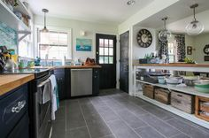 Eclectic Kitchen with loose open shelving island counter