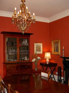 Red dining room....my dining room is red...going to get lots of ideas to make it work!