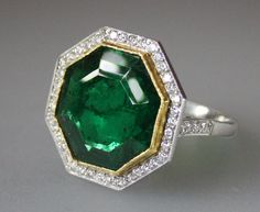 1950s Emerald Diamond Gold Platinum Ring | From a unique collection of vintage more rings at http://www.1stdibs.com/jewelry/rings/more-rings/