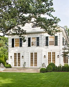 black shutters, french doors, nicely manicured lawn