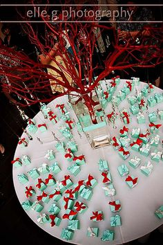 Red manzanita tree with hanging crystals. Kiss filled Tiffany Blue boxes with red, blue and white ribbon.