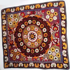 Antique Suzani. This decorative embroidery panel was hand-stitched by women using age-old traditions.This suzani is a vintage dowry piece, over 70 years old.