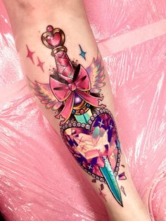 """Feb 2019 - """"Me: I want a dagger piercing a heart, but something that looks like a magical girl weapon. Tattoo artist:"""" Dope Tattoos, Girly Tattoos, Dream Tattoos, Anime Tattoos, Pretty Tattoos, Beautiful Tattoos, Body Art Tattoos, Hand Tattoos, Kawaii Tattoos"""