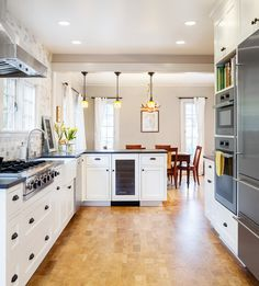Cork floors with white cabinets