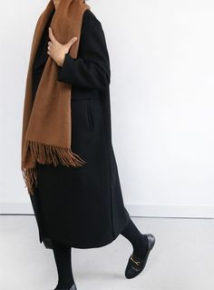 Black outfit and brown scarf. Death by Elocution.