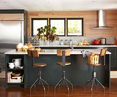 In this modern, open layout wall storage is used instead of upper cabinets (shown in another pin).