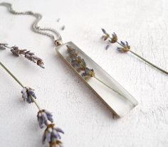 Pressed Flower Necklace - Lavender in resin - handmade preserved nature jewelry. $25.00, via Etsy.