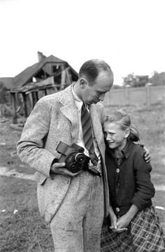 Photographer Julien Bryan comforts a ten-year-old Polish girl named Kazimiera Mika, whose older sister was killed in a field near Jana Ostroroga Street in Warsaw during a German air raid by Luftwaffe (September 1939)