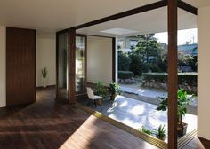 Sunset Villa by TT Architects, Kurashiki, Japan. Interior/Exterior seating area in room (master suite? Interior Exterior, Interior Architecture, Interior Design, Classic Furniture, Furniture Styles, Henley Homes, Villa, Small Courtyards, Chicago Furniture