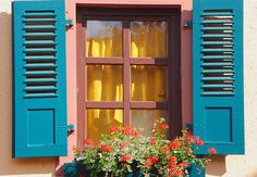 Blue Shutters With Yellow Curtains by Bachspics, via Flickr