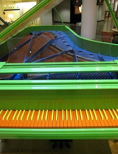 green, yellow, orange, blue grand piano