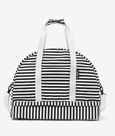 Weekender Bag by Kate Spade // Cellphone pockets and durable canvas make this a trendy-yet-practical carry-on.