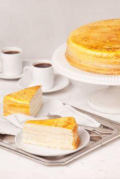 Our signature cake and famous worldwide, the Lady M Mille Crêpes feature no less than twenty paper-thin handmade crêpes layered with ethereal light pastry cream. Delicate and irresistible, the top gently caramelized till golden. Sink right in, alternating crêpe and cream layers literally melt in your mouth leaving a subtle sweet finish.