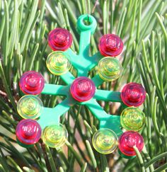 This cute ornament is sure to brighten up your tree! Measuring 2 in tall and 1.5 in. wide, this ornament is a great addition to any