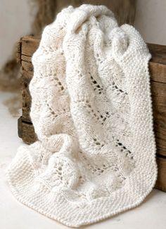 Glæd en nybagt mor med et lunt og blødt babytæppe i hulmønster med perlestrikket kant